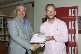 Dr. Stamos Karamouzis, Vice President of Academic Affairs of ACT, awards Angelos Dragkolas for his idea on the recording, digitization and management of water networks and sewerage.